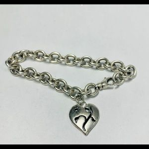 Silver chain bracelet with heart tag .925